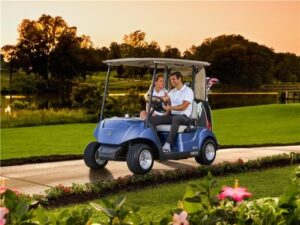 a washed golf cart and couple